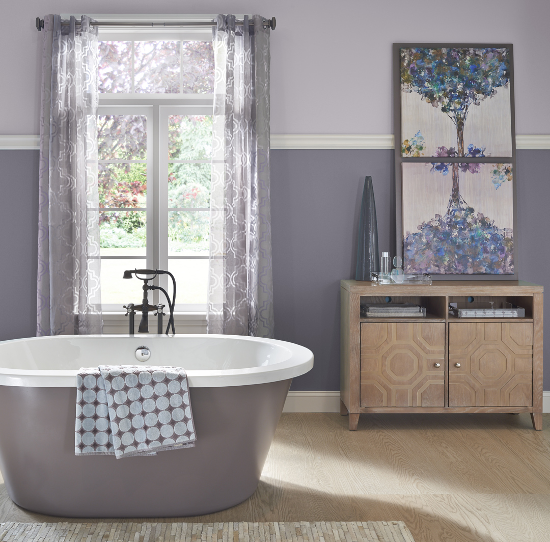 Inspirational small bathroom image with dark purple and light purple split walls and white trim.