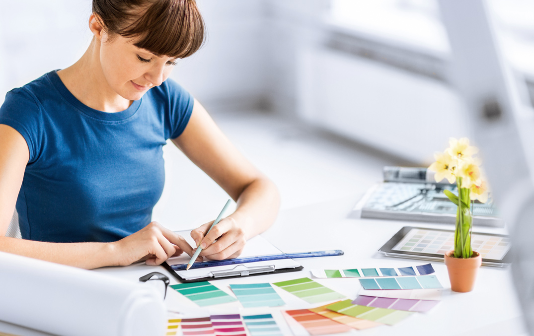 A woman looking at several different color palettes