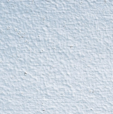 Close up image of a surface that has small, round conclave depressions when bubbles break in a paint film.